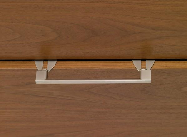 Adaptateur de poignée pour portes pliantes